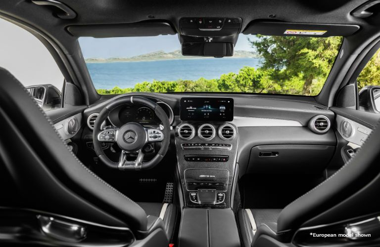2020 MB AMG GLC interior front cabin looking past seats to front window with trees and water