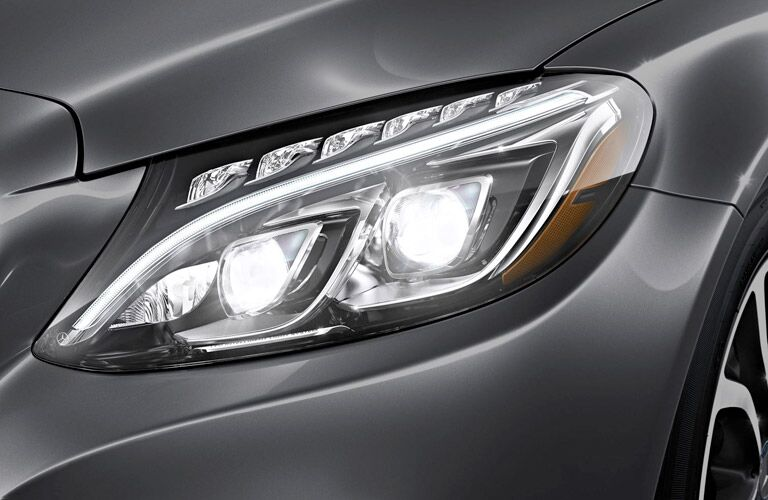 What kind of headlights does the Mercedes-Benz C-Class have?