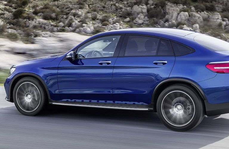 2018 Mercedes-Benz GLC Coupe exterior back fascia and drivers side going fast with blurred background