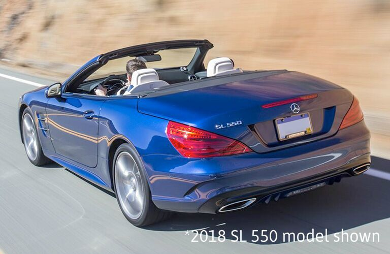 "rear view of blue mercedes-benz sl roadster with text that says ""2018 sl 550 model shown"""