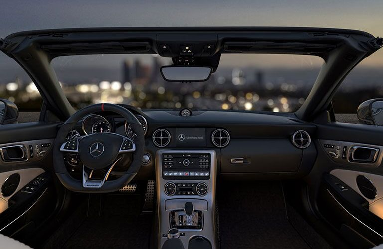 2018 Mercedes-Benz SLC Roadster with the top down overlook a city