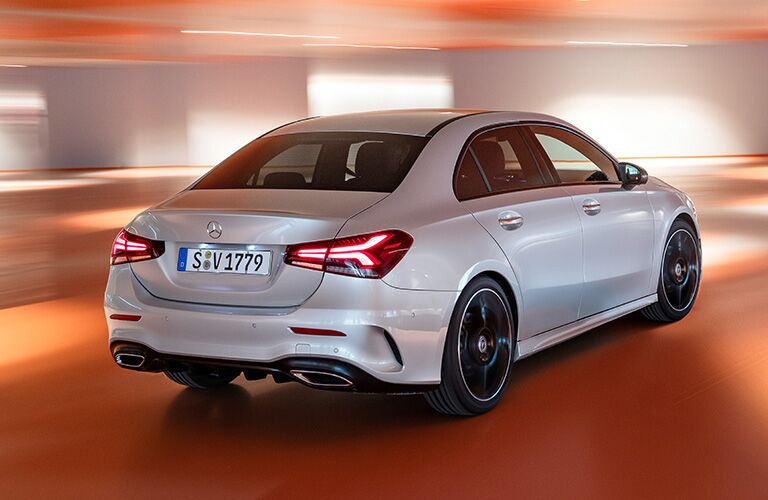 2019 MB A-Class exterior back fascia and passenger side with orange background