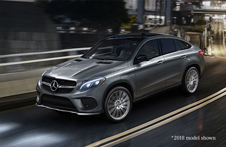 2019 MB AMG GLE 43 Coupe exterior front fascia and drivers side going fast on town road