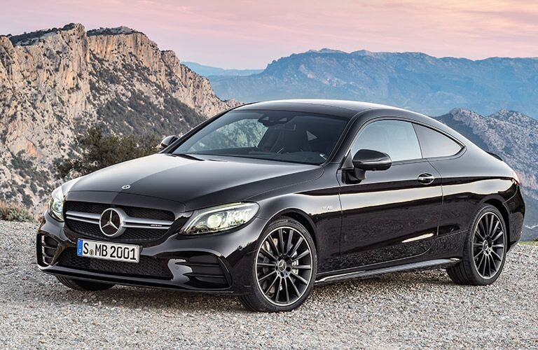 2019 MB C-Class Coupe exterior front fascia and drivers side with mountain range behind