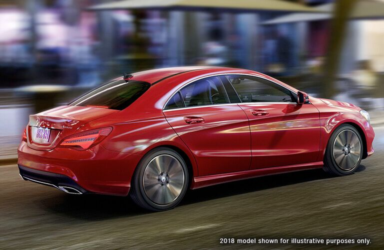 2018 MB CLA exterior back fascia and passenger side with blurred city surroundings