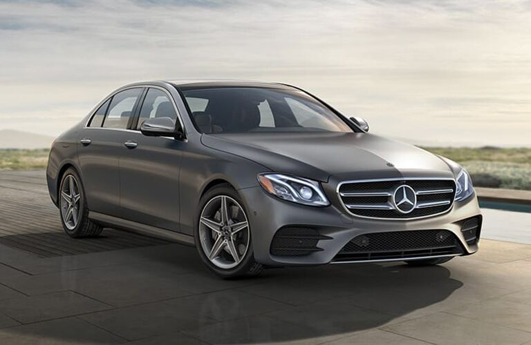 2019 MB E 300 exterior front fascia and passenger side parked in lot with grass in background