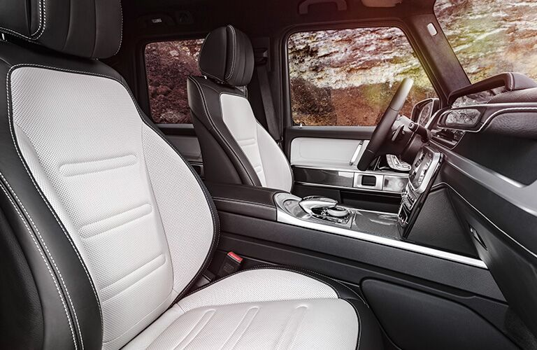 2019 MB G-Class interior front cabin side view of seats steering wheel and dashboard