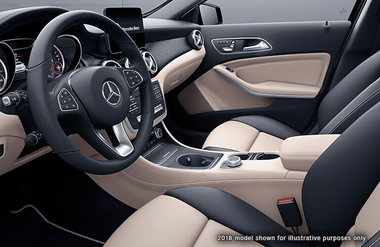 2019 MB GLA interior front cabin side view of seats steering wheel display screen and dashboard