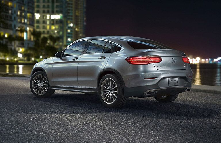2019 MB GLC Coupe exterior back fascia and drivers side at night in city