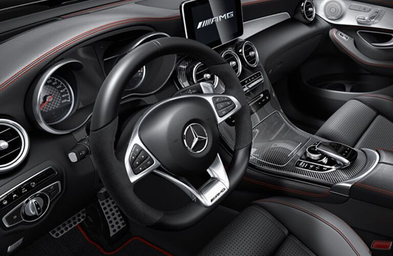 2019 MB AMG GLC 63 interior front cabin close up of steering wheel and partial dashboard