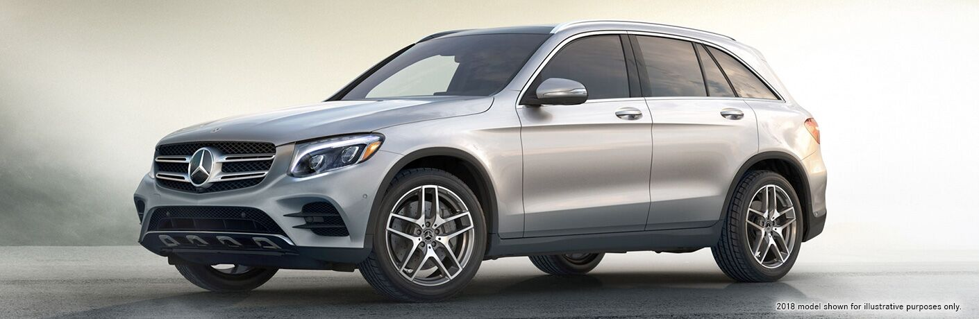 2019 MB GLC exterior front fascia and drivers side parked on tiled lot with hazy background