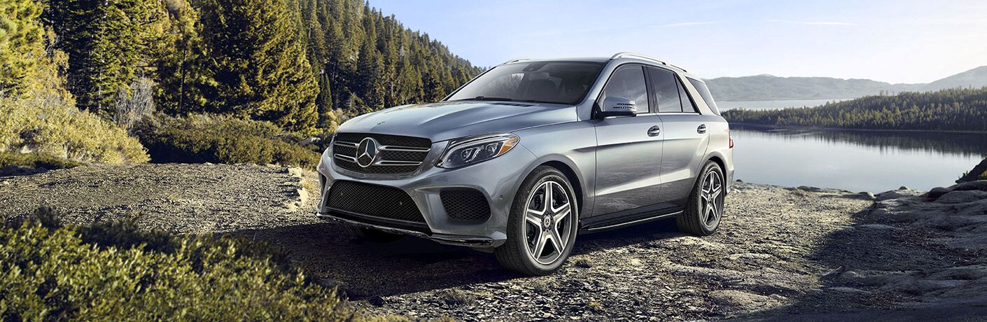 2019 MB GLE exterior front fascia and drivers side on gravel road with pine trees