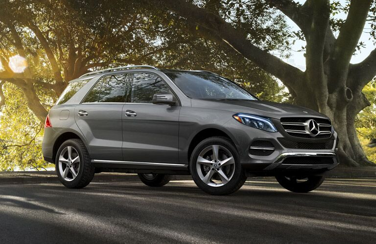 2019 MB GLE exterior front fascia and passenger side on road with tree
