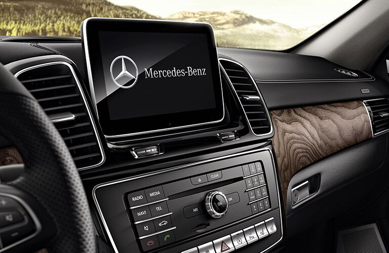 2019 MB GLE interior front cabin close up of display screen and partial dashboard