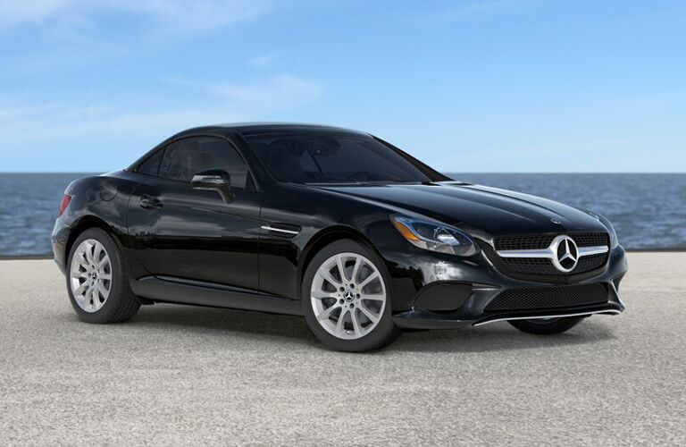 2019 MB SLC 300 Roadster exterior front fascia and passenger side with hood up on beach