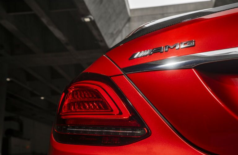 2019 MB C-Class exterior close up of AMG® badge on back fascia