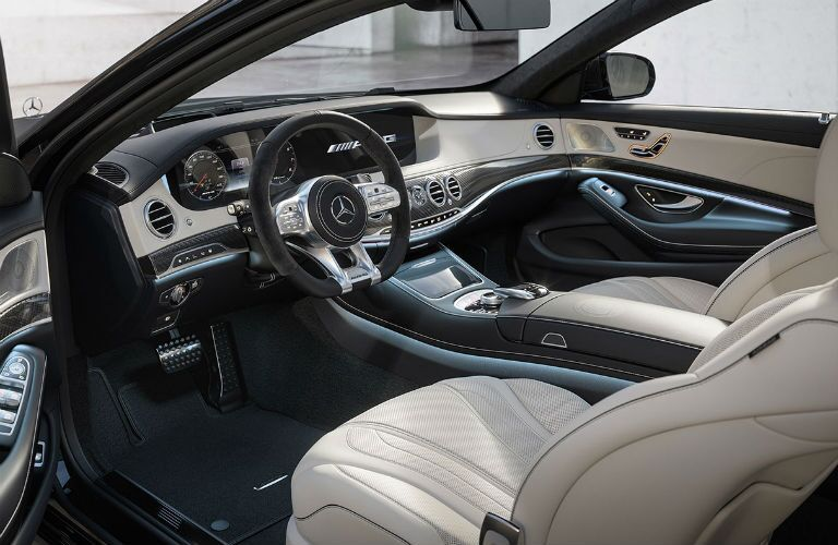 2019 MB AMG S 63 exterior looking into front cabin seats steering wheel and dashboard