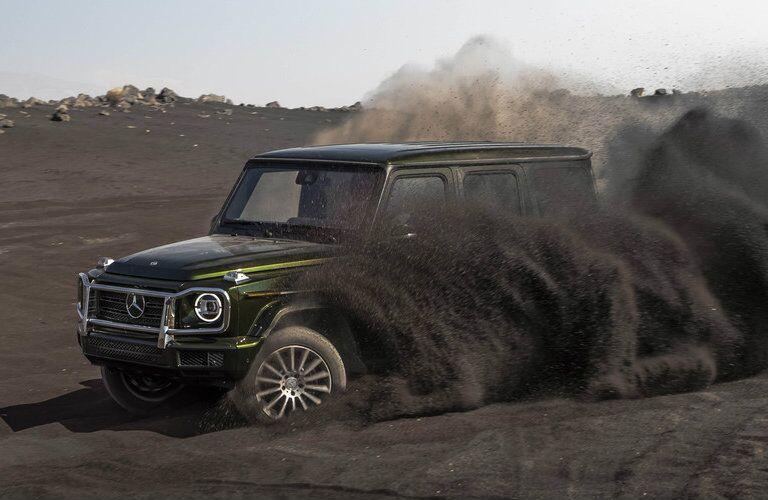 2019 Mercedes-Benz G-Class SUV driving in dirt