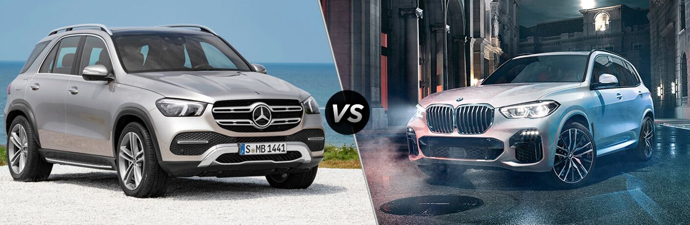 2020 MB GLE SUV exterior front fascia and passenger side on beach vs 2019 BMW X5 exterior front fascia and drivers side on town road