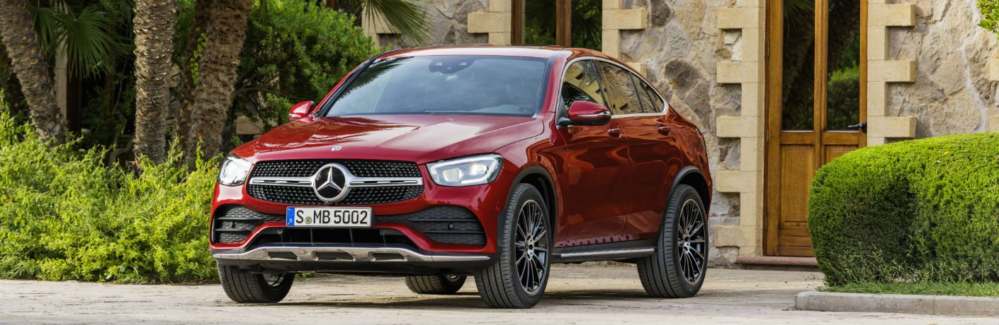 2020 MB GLC Coupe exterior front fascia and drivers side in front of stone house_o