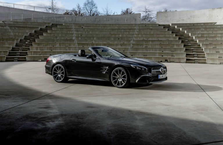 2020 MB SL Grand Edition exterior front fascia and passenger side parked in concrete stadium