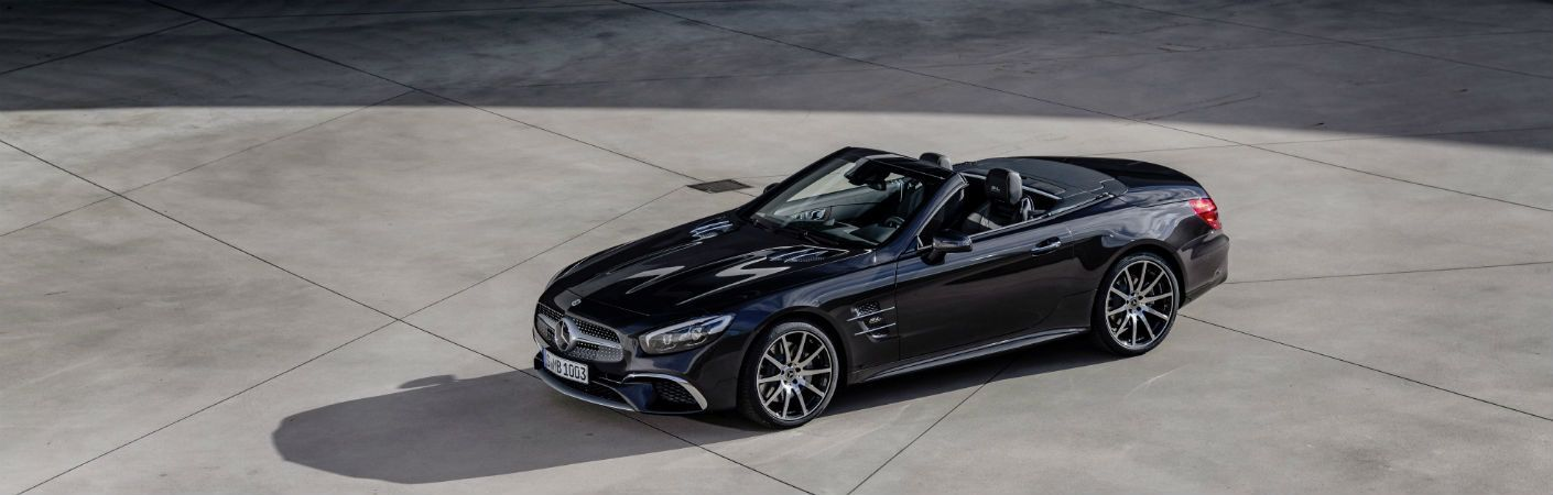 2020 MB SL Grand Edition exterior front fascia and drivers side parked in concrete stadium