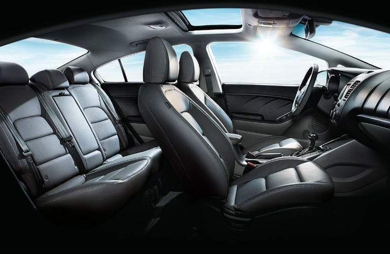 interior profile view of 2018 kia forte with sunroof showing both rows headroom and legroom