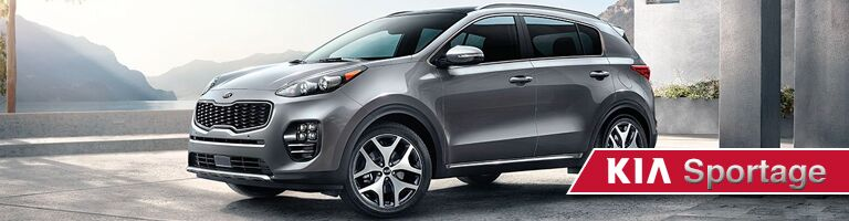 grey 2019 Kia Sportage with banner in bottom right corner