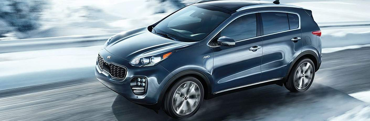 2018 Kia Sportage in Dayton, OH shown driving on snowy road matt castrucci kia