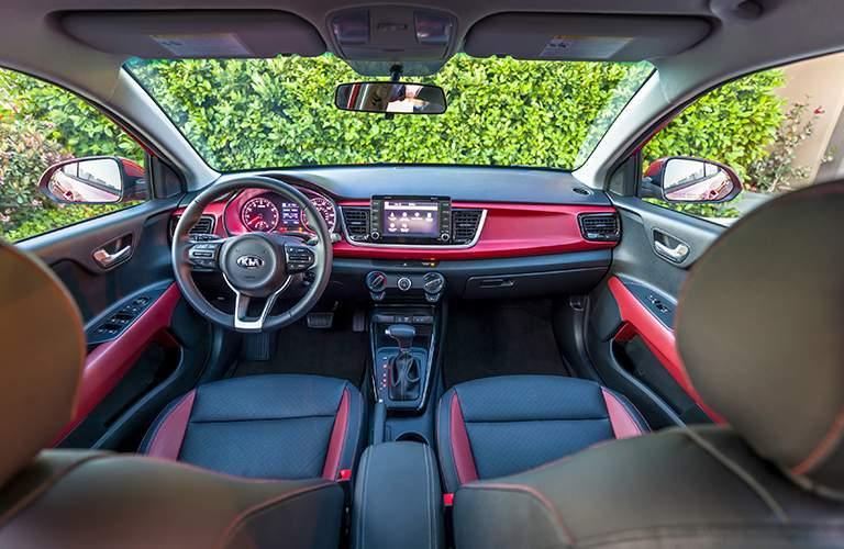 Interior front view of 2018 Kia Rio dash and wheel.
