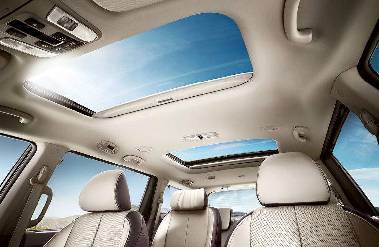 dual moonroofs in 2018 kia sedona shown from second-row seating