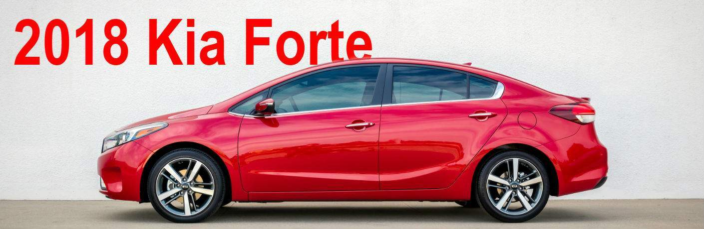 2018 kia forte against plain wall in stunning red color profile shot in dayton ohio