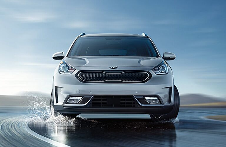 2019 Kia Niro driving on a wet road