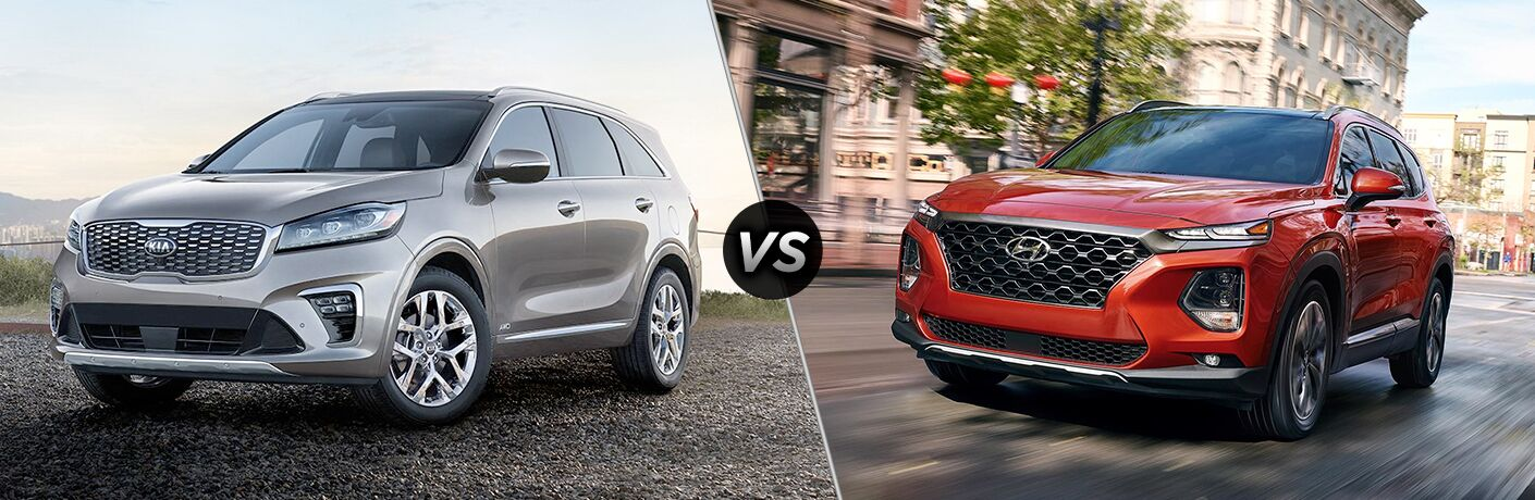 """Front driver side exterior view of a gray 2019 Kia Sorento """"vs"""" front exterior view of a red 2019 Hyundai Santa Fe"""