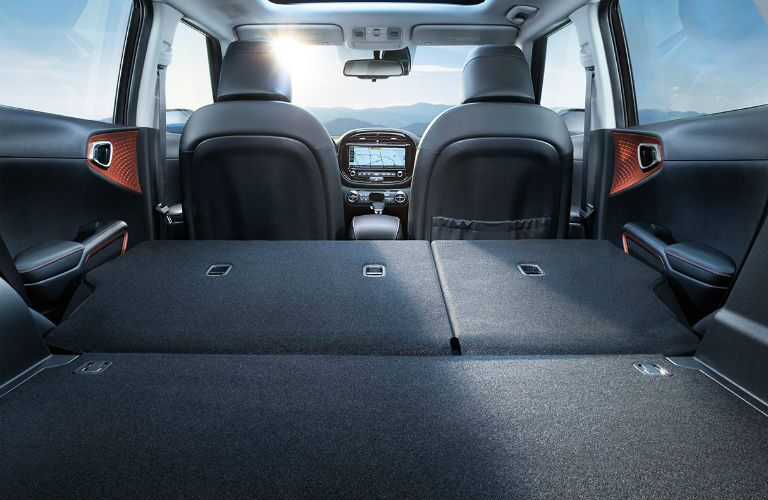 Rear seat of the 2020 Kia Soul folded flat for maximum cargo space