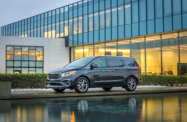 2020 Kia Sedona parked in front of a building