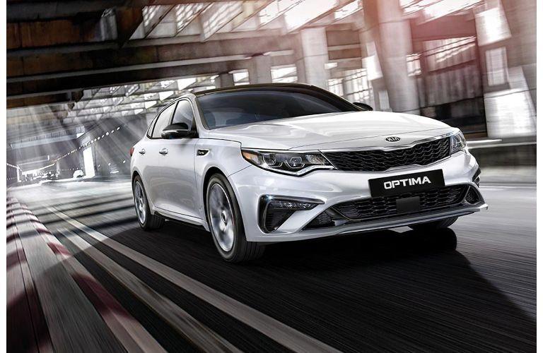 2020 Kia Optima driving through a large warehouse