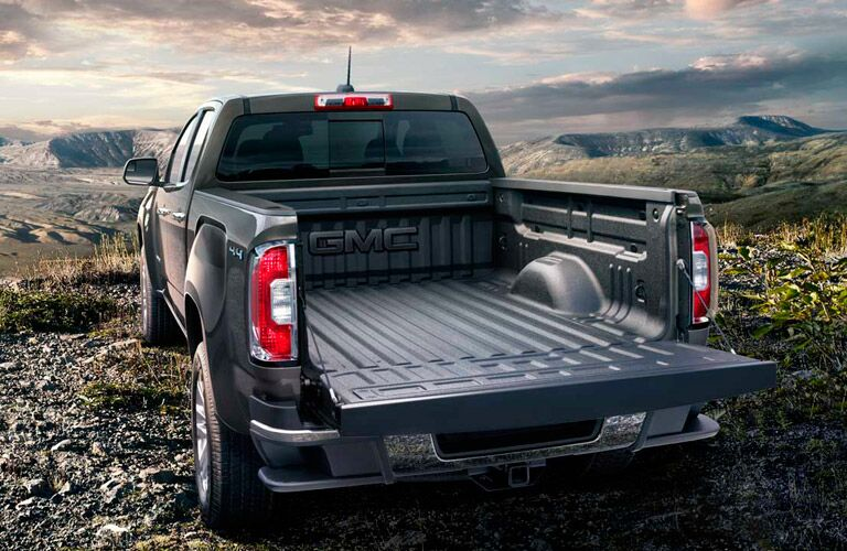 The tailgate of the 2016 GMC Canyon opens to fit almost anything you need to haul.