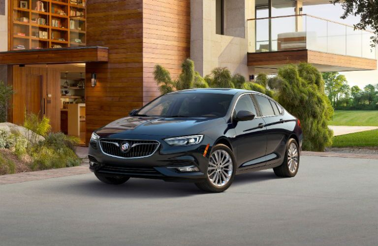 black 2018 buick regal sportback in driveway of modern home