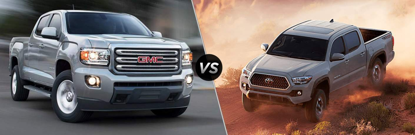 "Front exterior view of a gray 2018 GMC Canyon on the left ""VS"" front exterior view of a gray 2018 Toyota Tacoma on the right"