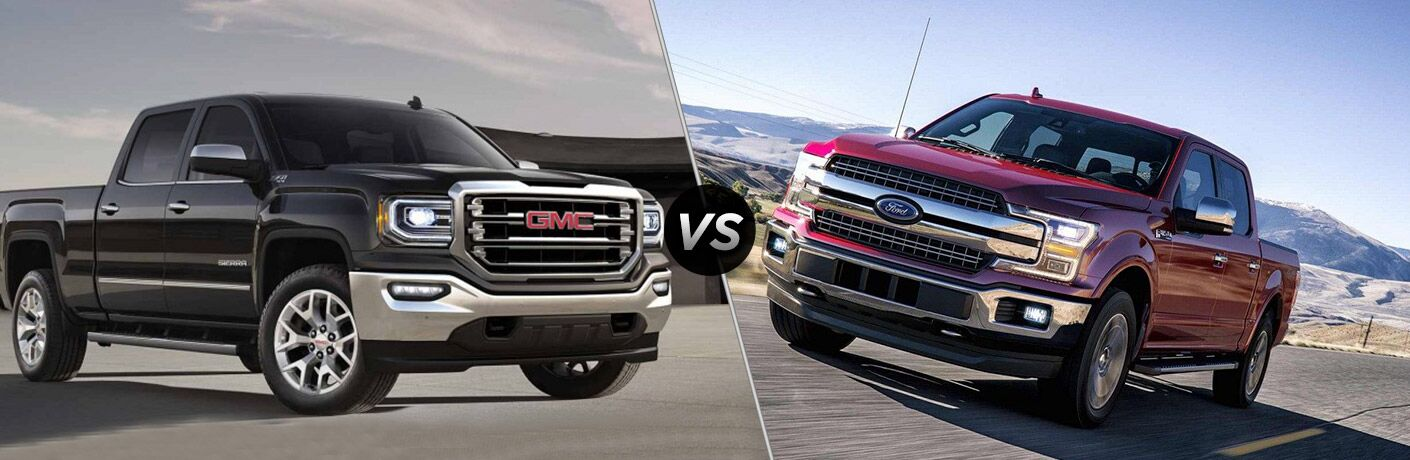 2018 GMC Sierra vs 2018 Ford F-150 with a vs sign.