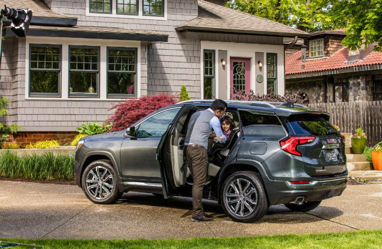 2018 GMC Terrain Denali parked in driveway with man opening back door