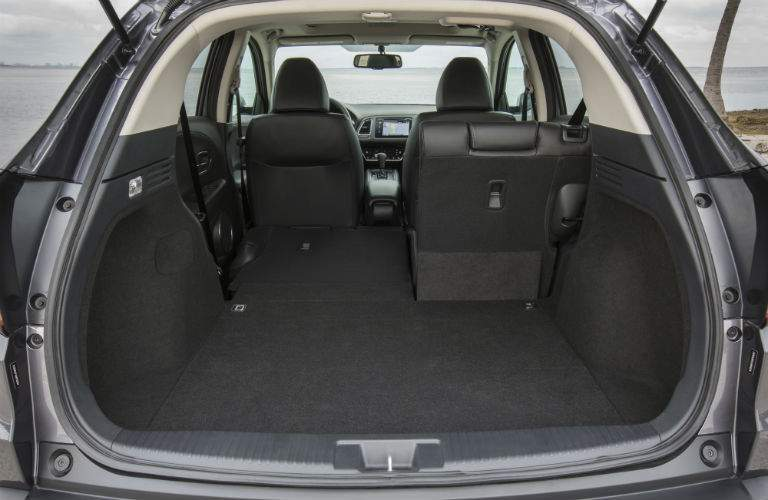 Rear cargo area of the 2018 Honda HR-V with half rear seat folded down
