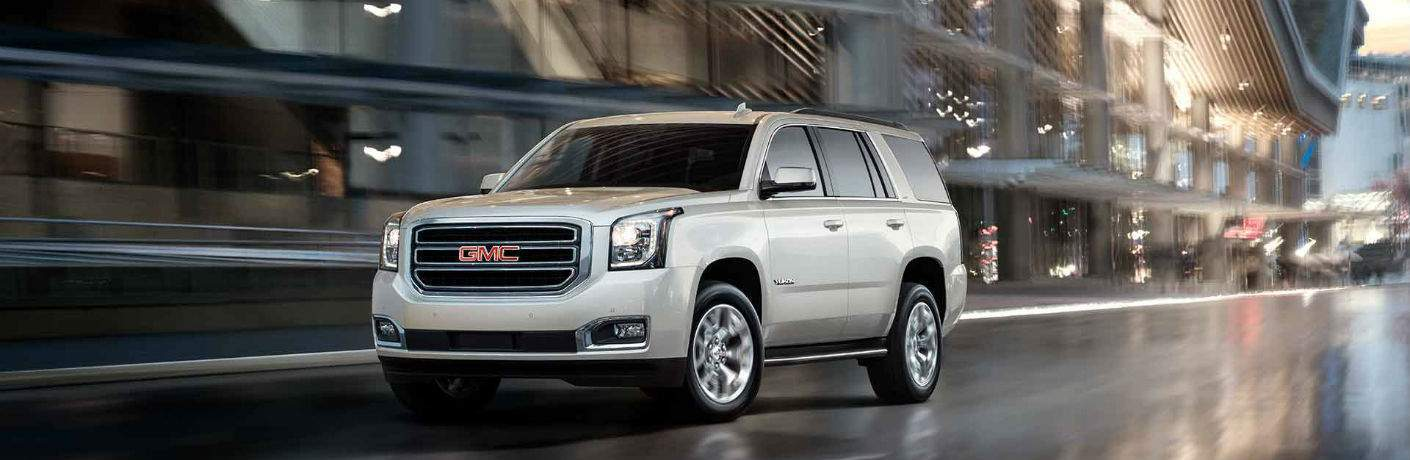 Driver's side exterior view of a white 2018 GMC Yukon