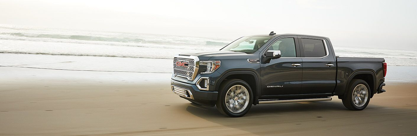 2019 GMC Sierra 1500 Denali driving on a beach