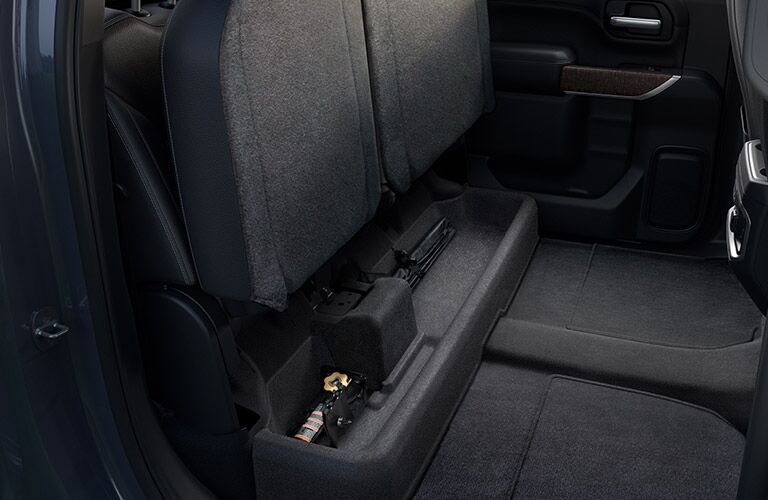 2019 GMC Sierra 1500 Denali rear seats folded up showing cargo space
