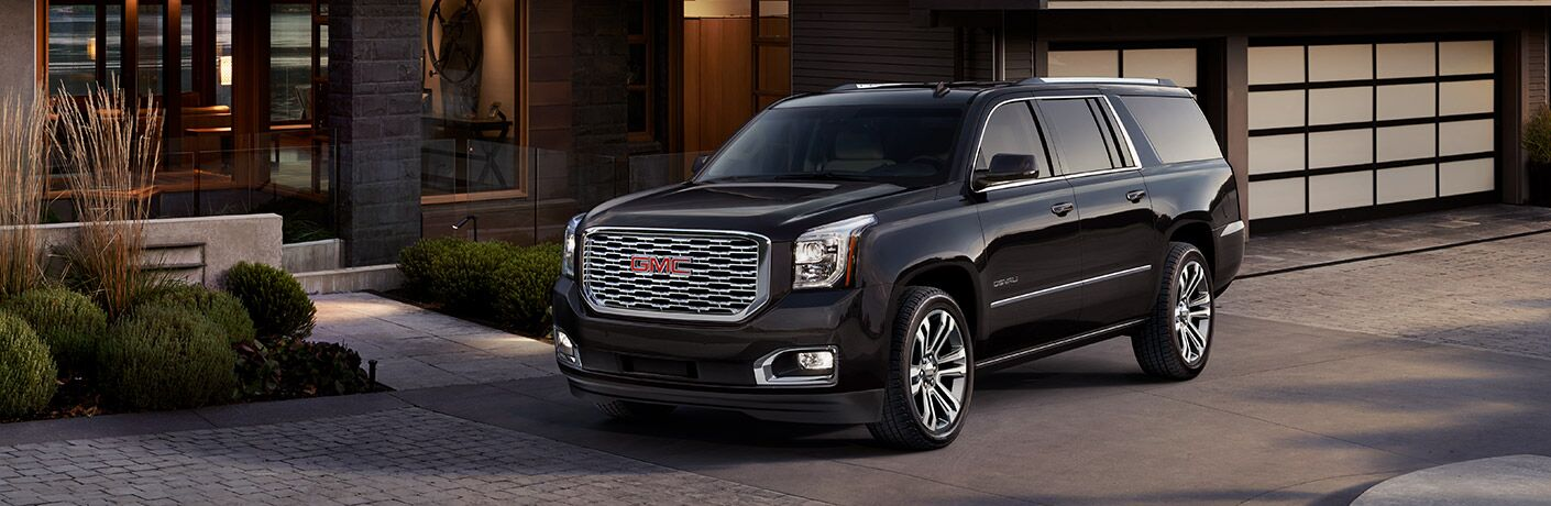 2019 GMC Yukon Denali parked in front of a house