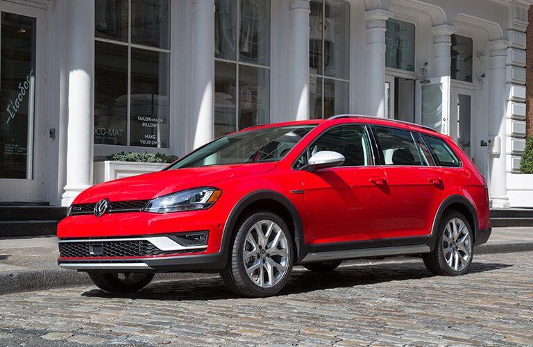 red 2017 Volkswagen Golf Alltrack exterior front parked
