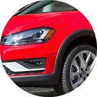 red 2017 VW Golf Alltrack front headlight