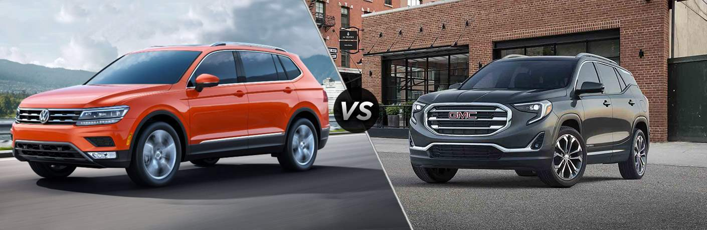 2018 Volkswagen Jetta parked by a mountain vs 2018 GMC Terrain parked outside of a brick building with big windows
